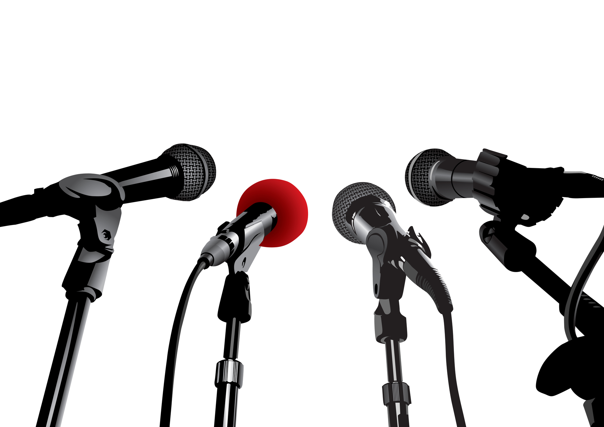 Four microphones facing each other against a white background