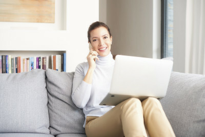 Woman on phone in home office