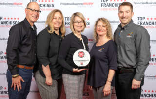 Wild Birds Unlimited team receiving 2020 Top Franchises Award