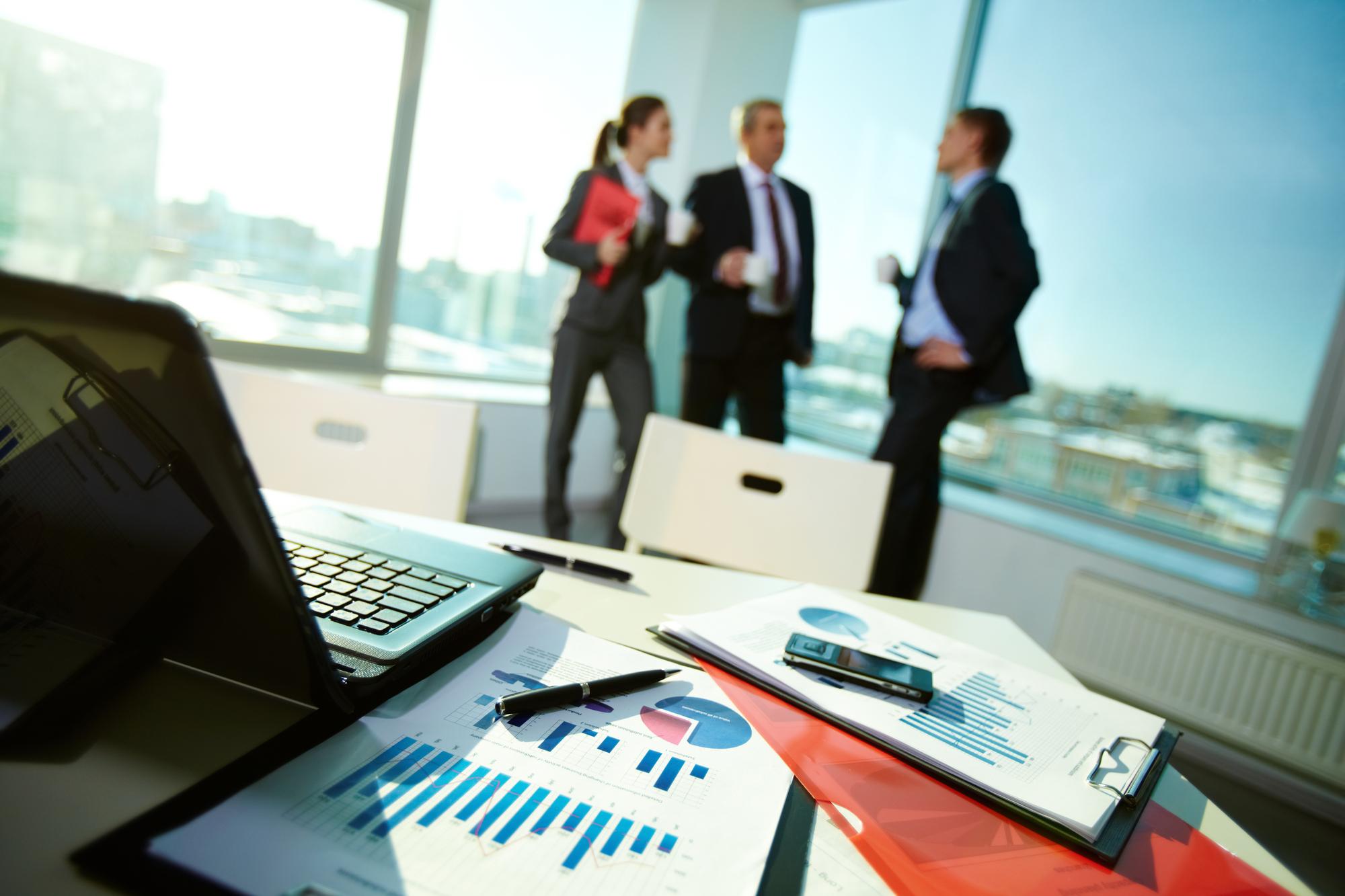 group of executives avoiding data documents